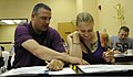 U.S. Air Force Tech. Sgt. Barry Armstrong, with the 8th Maintenance Group, and his wife Tech. Sgt. Gena Armstrong, with Public Affairs, 51st Fighter Wing, participate in a marriage retreat at U.S. Army Garrison 120811-F-GO396-160.jpg