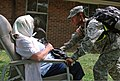 U.S. Army Spc. Stephanie Williams, right, a combat medic with the 690th Medical Company, attempts to calm a role player portraying a displaced civilian suffering from dementia July 31, 2012, during exercise 120731-A-AC168-342.jpg