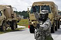 U.S. Army Staff Sgt. Tracy Rogers, a squad leader with the 108th Chemical Company, South Carolina Army National Guard, directs a vehicle during a vehicle decontamination exercise in support of Ardent Sentry 13 130519-Z-DH163-010.jpg