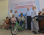 U.S. Congressional delegation attends a wheelchairs and hearing aids distribution event in Danang (13941347411).jpg