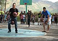U.S. Marine Corps Lance Cpl. Jose Zamudioguzman, left, and Lance Cpl. Marshal Schmidt, assigned to the 3rd Law Enforcement Battalion, compete in a two-basketball footrace during a community relations project 130323-N-VN372-391.jpg