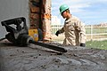 U.S. Marine Corps Pfc. Ismael Moctezumadelalanza, with the 9th Engineer Support Battalion, participates in a renovation project at Erdmiin Oyun High School in the Nalaikh district of Ulaanbaatar, Mongolia 130720-M-DR618-098.jpg