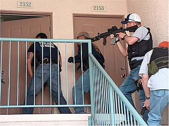 Police raid - Police and US Marshals in a raid.