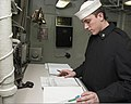U.S. Navy Aviation Electrician's Mate 2nd Class Richard Sweeny serves as petty officer of the watch aboard the aircraft carrier USS Nimitz (CVN 68) 130110-N-RC246-057.jpg
