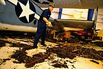 U.S. Navy Aviation Maintenance Administrationman 3rd Class Tyler Coughlin, assigned to the amphibious assault ship USS Nassau (LHA 4), moves sewage waste at the Lone Star Flight Museum while supporting civil 080921-N-KD705-421.jpg
