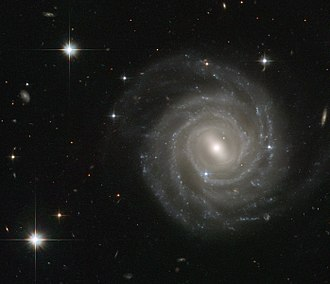 Milky Way - An HST image of galaxy UGC 12158, which is thought to resemble the Milky Way in appearance