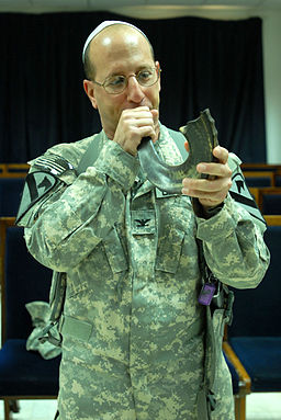 US Army 51054 VICTORY BASE COMPLEX, Iraq - Col. Steven Bernstein, from St. Louis, Mo. sounds the ram's horn, also known as a shofar in Hebrew, after a Rosh Hashanah service here, Sept. 20. The shofar was sounded t