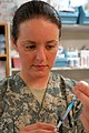 US Army 52427 BAGHDAD - Sgt. Janelle Graham, a health care specialist from Sacramento, Calif., fills a syringe with flu vaccination at the Battalion Aid Station, on Camp Liberty, Oct. 1. The vaccination is an inac.jpg