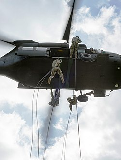 e9b8736aac6f7 Students at Camp Gruber practice rappelling from a UH-60 Black Hawk.