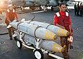 US Navy 021112-N-9593M-034 Aviation Ordnancemen prepare to move three Guided Bomb Units.jpg