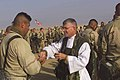 US Navy 030202-M-5150A-010 Chaplain Bill Devine from Boston, Mass., gives U.S. Marine Corporal Joseph Duarte a wafer during communion services.jpg