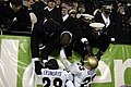 US Navy 031206-N-6157F-004 The Navy Midshipmen celebrate at the conclusion of the 104th playing of the Army Navy game.jpg