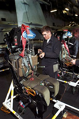 An Aviation Structural Mechanic works on an ejection seat removed from the cockpit of an EA-6B Prowler aboard USS John C. Stennis. US Navy 040616-N-6213R-001 Aviation Structural Mechanic 3rd Class Robert Hall, of Whidbey Island, Wash., works on a rocket propelled ejection seat, removed from the cockpit of an EA-6B Prowler.jpg
