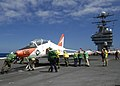 US Navy 040821-N-4748O-086 Flight deck personal perform a PUSH BACK on a T-45A Goshawk assigned to Training Air Wing Two (TW-2) on the flight deck.jpg