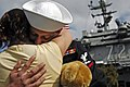 US Navy 050301-N-4166B-030 A Sailor, assigned to Carrier Air Wing Two (CVW-2), hugs his wife after returning home to San Diego, Calif., from a deployment aboard the Nimitz-class aircraft carrier USS Abraham Lincoln (CVN 72).jpg