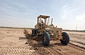 US Navy 050303-N-6027E-003 Equipment Operator 3rd Class Chad Brown of Saratoga, N.Y., clears a section of land at Camp Morreel on Ali Al Salem Air Base, Kuwait.jpg