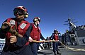 US Navy 050428-N-4309A-038 Damage Controlman 3rd Class Christian Covarrobiasorte leads his hose team during a crash and salvage fire drill aboard the guided missile destroyer USS O'Kane (DDG 77).jpg
