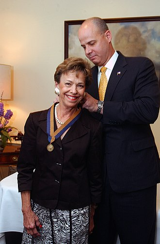Navy Meritorious Public Service Award - Under Secretary of the Navy, Dino Aviles, presents the Navy Meritorious Public Service Award to Margaret Dalton, former President of the Society of Sponsors.