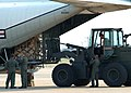 US Navy 050903-N-6046R-015 U.S. Navy personnel, assigned to Fleet Logistic Support Squadron Five Four (VR-54), load a C-130 Hercules aircraft with supplies bound for New Orleans and surrounding areas for relief efforts from Hur.jpg