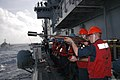 US Navy 060215-N-2970T-005 Gunner's Mate Seaman Travis D. Parker prepares to shoot an M-14 rifle with shot line adapter to the Military Sealift Command (MSC) underway replenishment oiler USNS Walter S. Diehl (T-AO 189).jpg