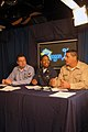 US Navy 060301-N-7130B-156 Photographer's Mate 1st Class John Lill, left, Chief Warrant Officer Theresa Payne, center, and Chief Boatswain's Mate Dante Zamora, right, offer an honest critique of potential contestant.jpg