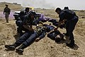 US Navy 060509-N-4614W-052 Iraqi patrol officers with the Oil Protection Force tend to a fellow officers injured by a simulated improvised explosive device during training at the Northern Oil Company compound outside Kirkuk.jpg