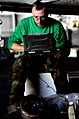 US Navy 061116-N-0555B-234 Aviation Machinist's Mate 2nd Class Thomas Worman reviews maintenance procedures for an F-A-18E Hornet assigned to the.jpg