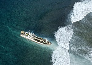 2007 Solomon Islands earthquake - Taiwanese fishing vessel aground on a reef while participating in relief operations