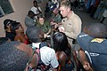 US Navy 070905-N-8704K-022 Chief Hospital Corpsman Joseph Colon, attached to Military Sealift Command hospital ship USNS Comfort (T-AH 20), speaks with local Creole translators before starting medical operations at Hôpital Univ.jpg