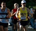 US Navy 071028-N-1580K-037 Navy runner Timothy Fahey keeps the pace ahead of British Royal Navy runner Wayne Dashper during the 32nd Marine Corps Marathon.jpg