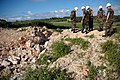 US Navy 071201-N-7367K-003 Seabees with U.S. Naval Mobile Construction Battalion (NMCB) 1, Guam Det., and the 30th Naval Construction Regiment examine the Orote Point rock quarry on board Naval Base Guam.jpg