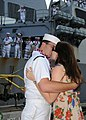 US Navy 081001-N-9758L-125 Sonar Technician (Surface) 3rd Class Andreas Arredondo kisses his wife during a first kiss ceremony pier side onboard Naval Station (NAVSTA) Pearl Harbor.jpg