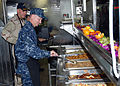 US Navy 081219-N-0803S-011 Master Chief Petty Officer of the Navy (MCPON) Rick West prepares to serve lunch to Sailors and Marines.jpg