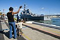 US Navy 090914-N-6674H-006 Family members wave as the guided-missile destroyer USS Hopper (DDG 70) departs Naval Station Pearl Harbor for a scheduled deployment to the U.S. 5th Fleet area of responsibility.jpg