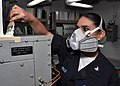 US Navy 091228-N-2013O-040 Gas Turbine System Technician (Electrical) 3rd Class Alejndra Murillo, from Las Vegas, paints an air conditioning unit while conducting ship preservation aboard the Arleigh Burke-class guided-missile.jpg