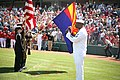 US Navy 100324-N-3271W-097 Navy Counselor 1st Class Steven Powell sings the national anthem before a pre-season Major League baseball game between the Los Angeles Angels and the Kansas City Royals at Tempe Diablo Stadium.jpg