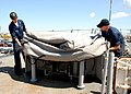 US Navy 100914-N-4959G-033 Boatswain's Mates 3rd Class Kirstopher Reynolds and Hank Cluck cover equipment with one of the Navy's new Envelop protec.jpg
