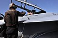 US Navy 110404-N-0569K-014 A plane captain signals to the pilots of an F-A-18F Super Hornet that the aircraft is ready for flight operations aboard.jpg