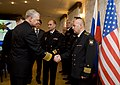 US Navy 110414-N-ZB612-045 Chief of Naval Operations (CNO) Adm. Gary Roughead is greeted by senior officers of the Russian Federation Navy.jpg