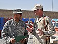 US Navy 110606-N-IA881-002 Spc. Johnny J. Butler Jr. talks with Capt. Allan M. Stratman after receiving the Purple Heart medal.jpg