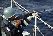 US Navy 110922-N-RI844-133 A Bangladesh navy sailor fires a Type-56 assault rifle aboard the Bangladesh navy frigate BNS Bangabandhu (F 25) during