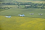 Ukraine SU-27s fly with Alabama Air National Guard F-16 Fighting Falcons over Ukranian sunflower fields during SAFE SKIES 2011.jpg