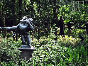 Umlauf Sculpture Garden and Museum - Umlauf's The Kiss (Bronze 1970) is the centerpiece of the sculpture garden pond. Another of his bronzes, The Diver (1956, on far right), stands at the water's edge.