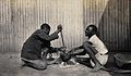 Umtali, Zimbabwe; two African boys stirring a cooking pot. P Wellcome V0038017.jpg