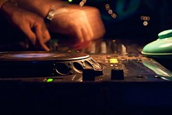 Vagator, Goa, India, DJ playing music on turntable.jpg