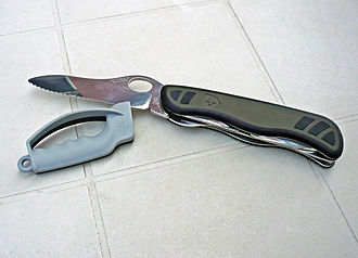 Sharpening - A hand-held tungsten carbide knife sharpener, with a finger guard, can be used for sharpening plain and serrated edges on pocket knives and multi-tools.