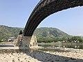 View of Tenshu of Iwakuni Castle beneath Kintaikyo Bridge.jpg