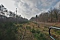 View of an abandoned train track from the back of the SNCB B22495 type-K3 carriage in As, Belgium (DSCF3109-hdr).jpg