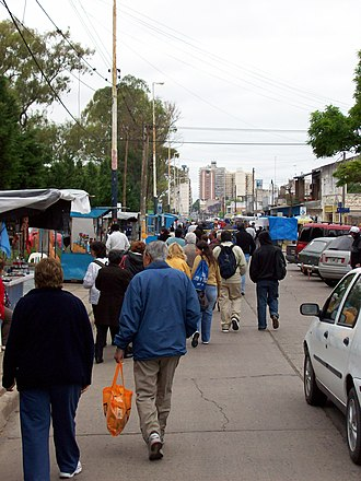 Our Lady of the Rosary of San Nicolás - Pilgrims walking along Sarmiento Avenue, lined with religious merchandise booths, leading to the Sanctuary of Our Lady of the Rosary of San Nicolás of the Arroyas, in Argentina