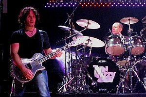 The guitarist and drummer performing